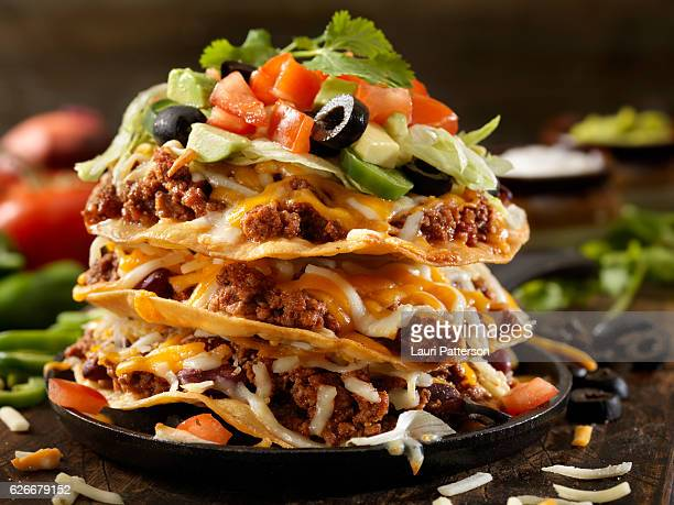 chilli cheese tostada tower - nachos stock photos and pictures