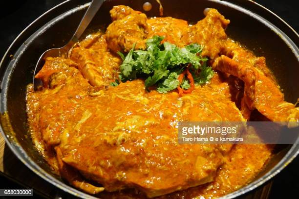 chilli crab, local and famous seafood in singapore - chilli crab stock photos and pictures