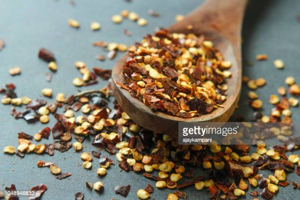 chilli flakes - red bell pepper stock pictures, royalty-free photos & images