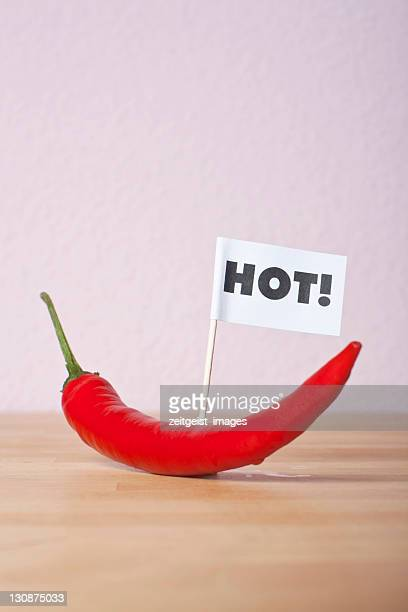 chilli pepper, flag saying hot! - captions stock photos and pictures