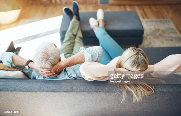 chilling comfortably on the couch - feet up stock pictures, royalty-free photos & images