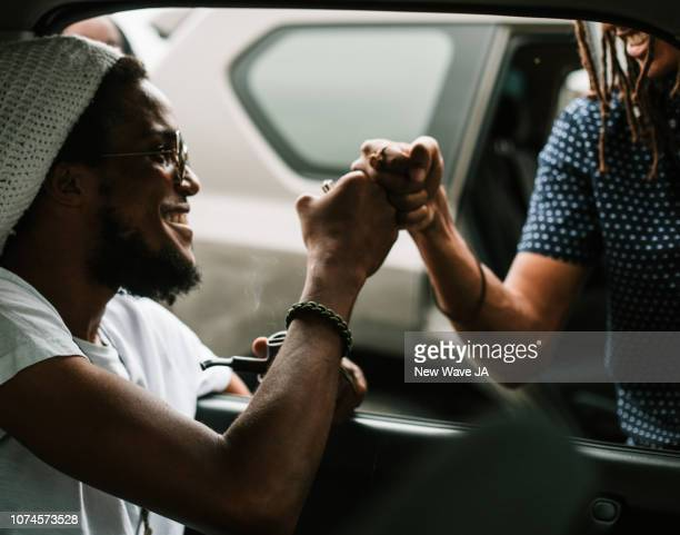 chilling in car - kingston jamaica stock pictures, royalty-free photos & images