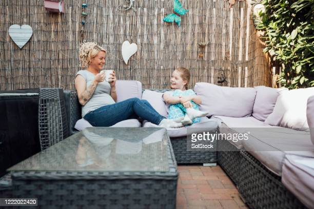 chilling in the garden with mummy - seat stock pictures, royalty-free photos & images