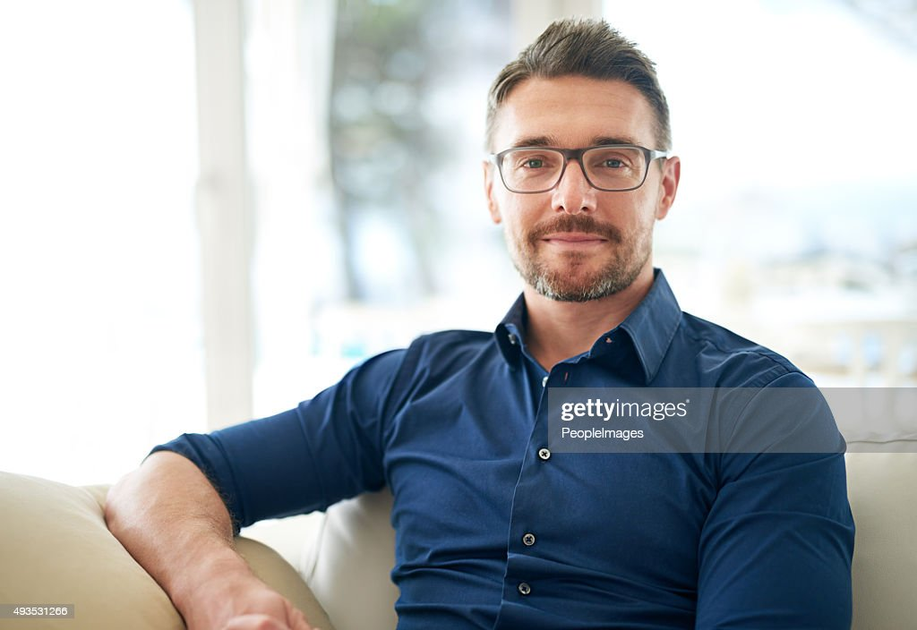 Chilling on the couch for a while : Stock Photo