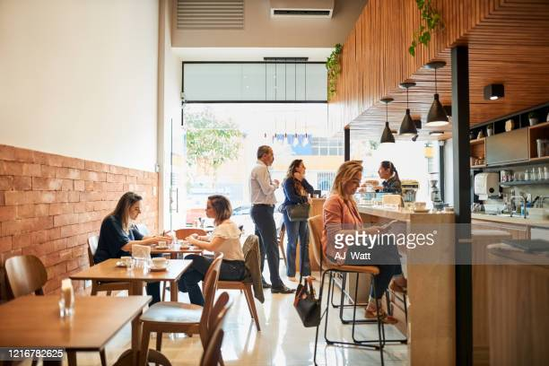 chilling out at a coffee shop - coffee shop stock pictures, royalty-free photos & images