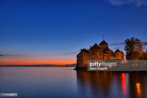 chillon castle (chateau de chillon) located on lake geneva at sunset. chillon castle, montreux, lake geneva, canton of vaud, switzerland. - montreux stock pictures, royalty-free photos & images