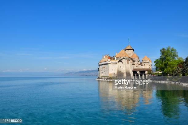 chillon castle (chateau de chillon) located on lake geneva with clear blue sky. chillon castle, montreux, lake geneva, canton of vaud, switzerland. - montreux stock pictures, royalty-free photos & images