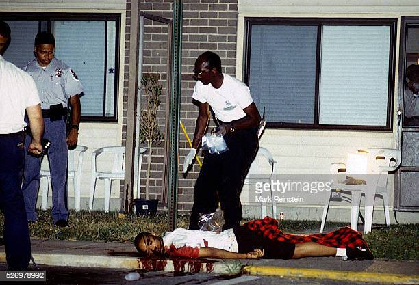 Chillum Maryland 1993 Police officers and homicide detectives investigate the scene of a double murder where twin teenage boys were shotgunned to...
