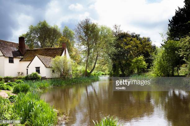 chilly springtime sun on famous beauty spot and tourist destination on river stour in essex england - eastern england stock photos and pictures