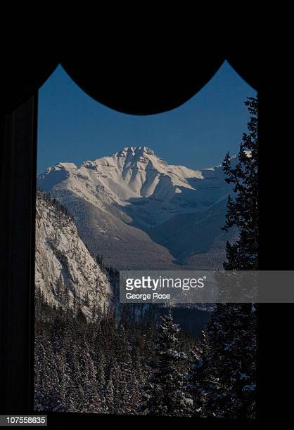 A chilly sunrise view of the Rocky Mountains from a Fairmont Banff Springs Hotel suite on November 22 2010 in Banff Springs Canada The famed hotel...