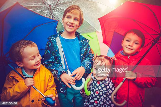 Chilren under umbrella