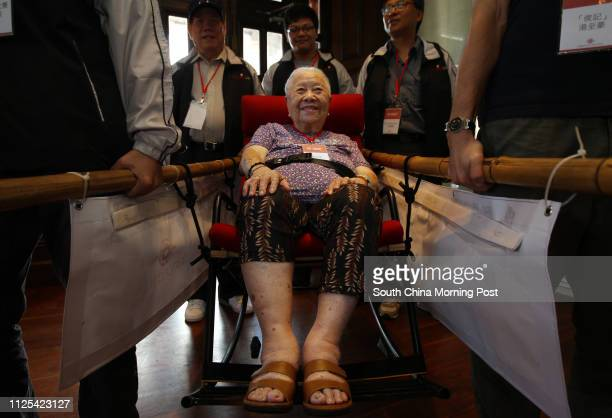 Chim Yaokiu tries on a Sedan chair made for the wheelchair bounded by Diamond Cab Chim nicknamed Auntie Bao is one of the very few Sedan chair ladies...