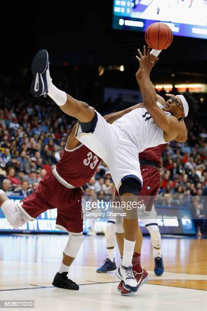Chima Moneke of the UC Davis Aggies battles for the ball against the North Carolina Central Eagles in the second half during the First Four game in...