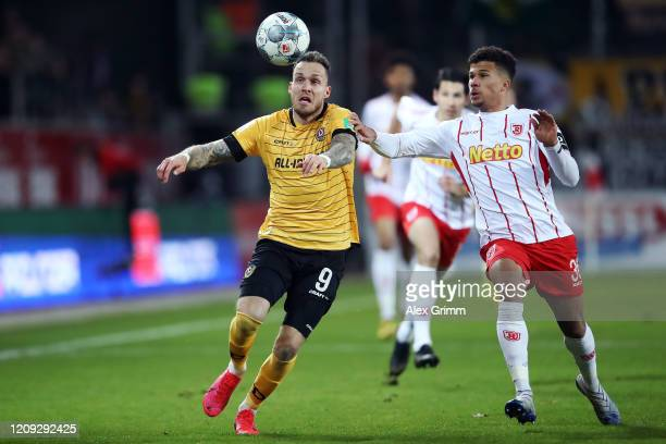 Chima Okoroji of Regensburg is challenged by Patrick Schmidt of Dresden during the Second Bundesliga match between SSV Jahn Regensburg and SG Dynamo...