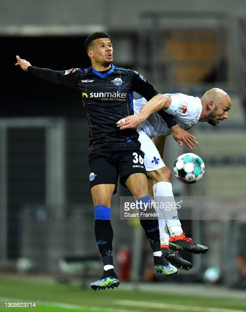 Chima Okoroji of SC Paderborn battles for possession with Patrick Herrmann of SV Darmstadt 98 during the Second Bundesliga match between SC Paderborn...