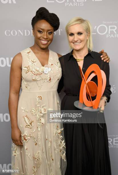 Chimamanda Ngozi Adichie and Maria Grazia Chiuri pose with an award backstage at Glamour's 2017 Women of The Year Awards at Kings Theatre on November...