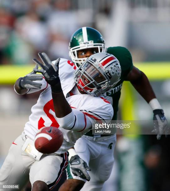 Chimdi Chekwa of the Ohio State Buckeyes breaks up a pass intended for B. J. Cunningham of the Michigan State Spartans on October 18, 2008 at Spartan...