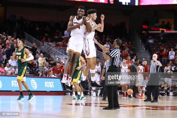 Chimezie Metu and Bennie Boatwright of the USC Trojans celebrate at half court after taking a ten point lead 7060 against the North Dakota State...