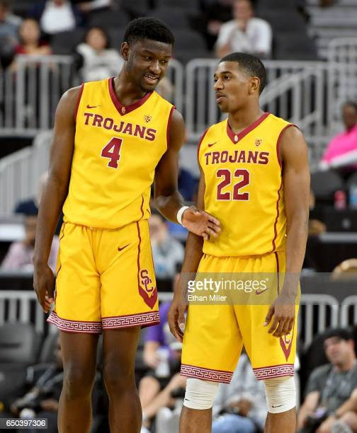 Chimezie Metu and De'Anthony Melton of the USC Trojans talk on the court during a firstround game of the Pac12 Basketball Tournament against the...