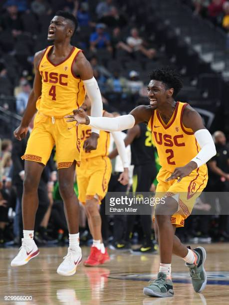 Chimezie Metu and Jonah Mathews of the USC Trojans celebrate on the court after teammate Elijah Stewart hit a 3-pointer against the Oregon Ducks...