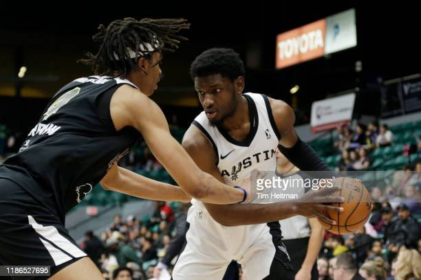 Chimezie Metu of the Austin Spurs is guarded by Moses Brown of the Texas Legends during the fourth quarter on December 4th, 2019 at Comerica Center...