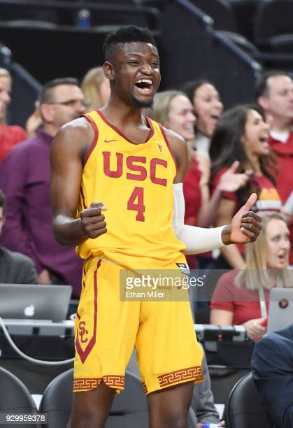 Chimezie Metu of the USC Trojans celebrates on the bench late in a semifinal game of the Pac-12 basketball tournament against the Oregon Ducks at...