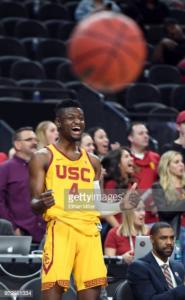Chimezie Metu of the USC Trojans celebrates on the bench late in a semifinal game of the Pac12 basketball tournament against the Oregon Ducks at...