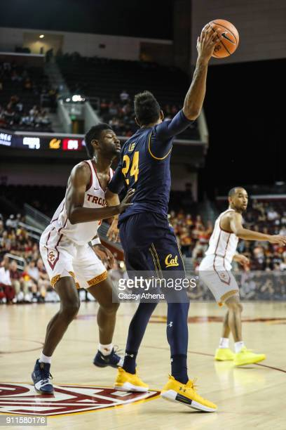 Chimezie Metu of the USC Trojans defends againt Marcus Lee of the California Golden Bears during a NCAA PAC12 college basketball game at Galen Center...