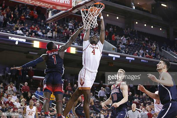 Chimezie Metu of the USC Trojans goes to the basket against Rawle Alkins of the Arizona Wildcats during NCAA Pac12 conference college basketball game...