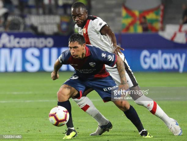 Chimi Avila of SD Huesca and Giannelli Imbula of Rayo Vallecano during the La Liga match between SD Huesca and Rayo Vallecano at El Alcoraz on...