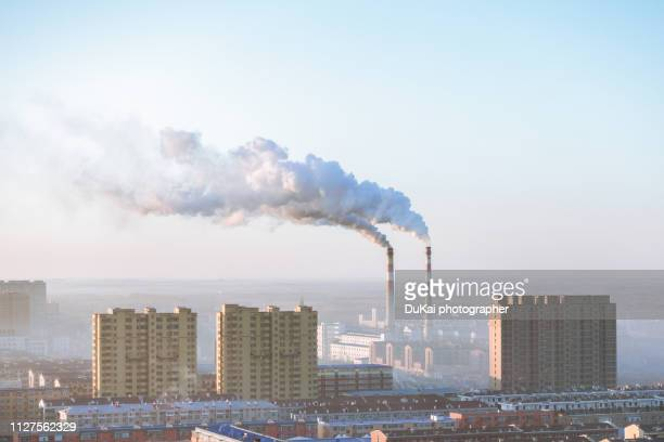 chimney in beijing - carbon dioxide stock photos and pictures