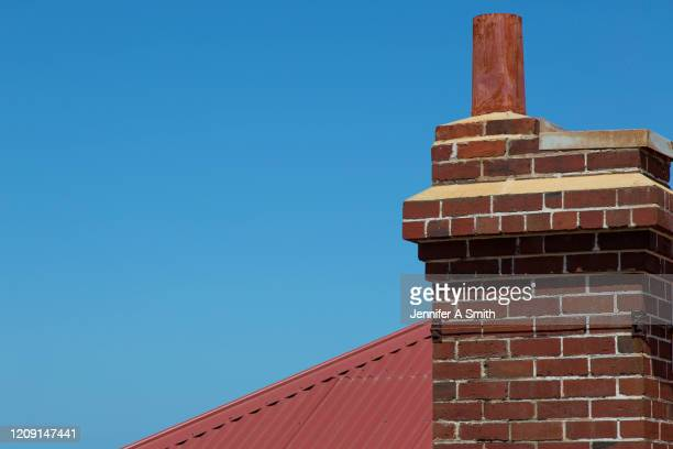 chimney - brick house stock pictures, royalty-free photos & images
