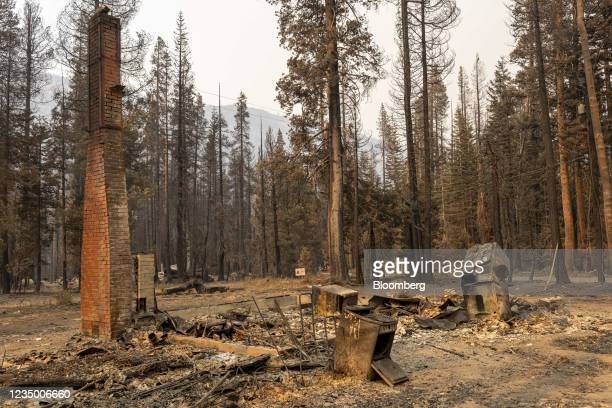 Chimney remains among the ruins of a house burned down during the Caldor Fire in Twin Bridges, California, U.S., on Wednesday, Sept. 1, 2021....