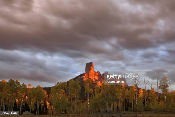 Chimney Rock and Courthouse Mountain glowing red at sunset