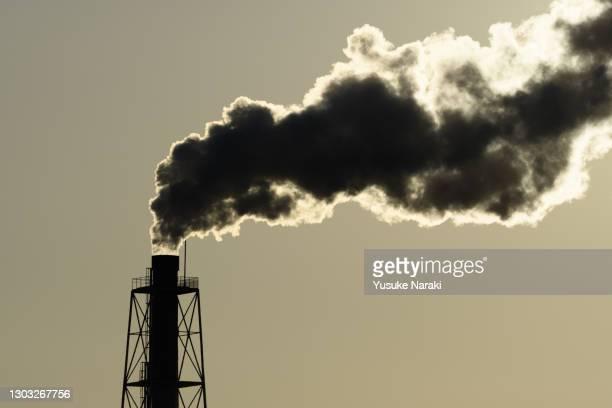 chimney smoke - environmental damage stock pictures, royalty-free photos & images