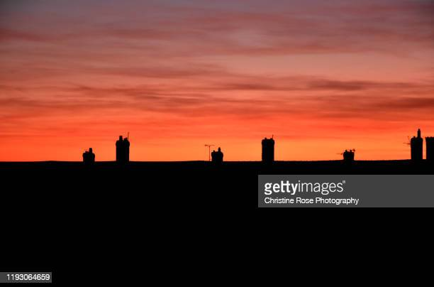 chimney stacks and sunsets - sunset stock pictures, royalty-free photos & images