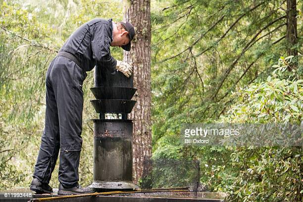 chimney sweep cleaning chimney - sweeping stock pictures, royalty-free photos & images