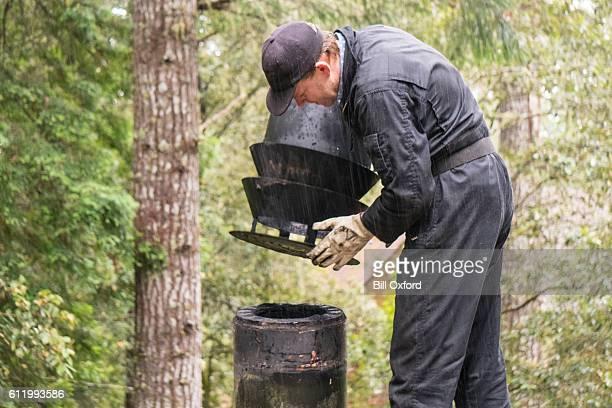 chimney sweep cleaning chimney - schornsteinfeger stock-fotos und bilder