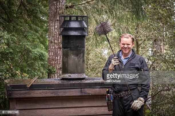 chimney sweep cleaning - schornsteinfeger stock-fotos und bilder