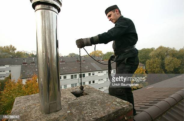 Chimney sweep on a roof at the sweeping up of a chimney