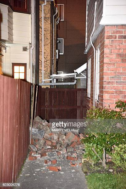 A chimney that collapsed into the yard of the Fiji High Commission is seen in Wellington early on November 14 2016 following an earthquake centred...