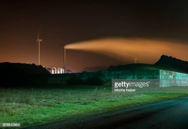 Chimney, wind turbine and coal in Eemshaven harbour area, Delfzijl, Groningen, Netherlands