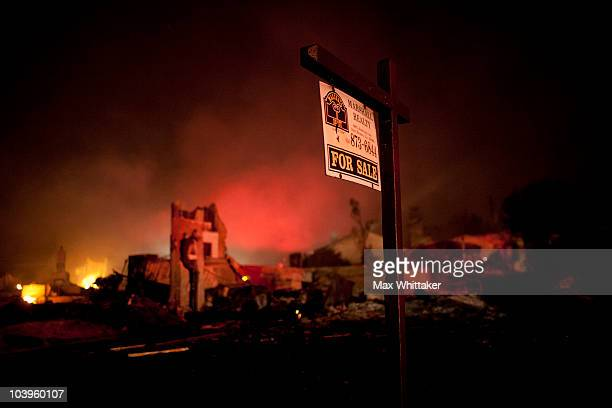 Chimneys and a real estate for sale sign remain after a massive fire in a residential neighborhood September 9 2010 in a San Bruno California A...