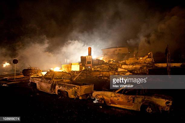 Chimneys and burntout cars remain after a massive fire in a residential neighborhood September 9 2010 in a San Bruno California A massive explosion...