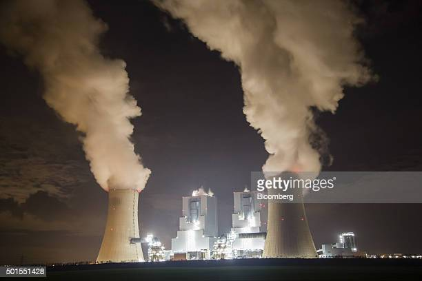 Chimneys emit vapor into the night sky at the Garzweiler lignite power plant operated by RWE AG in Garzweiler Germany on Tuesday Dec 15 2015 Global...