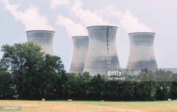 chimneys in use at a modern power plant - stock photo - tower stock pictures, royalty-free photos & images