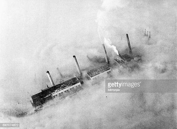 Chimneys of an East End factory poke through the blanket of smog covering London Circa 1952