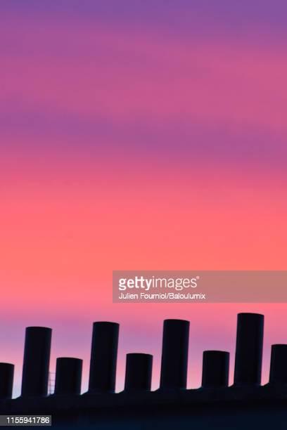 chimneys of parisian roofs, france - île de france stock-fotos und bilder