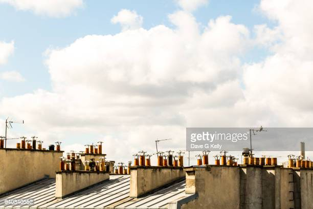 chimneys on rooftops - toit photos et images de collection