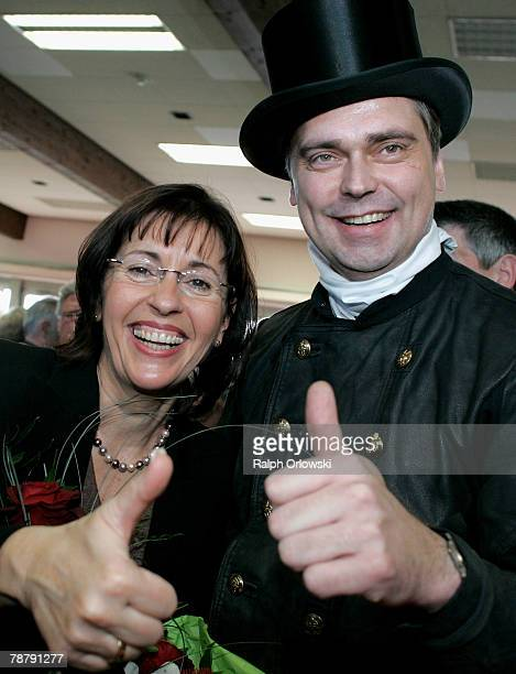 Chimneysweeper Veit Wilhelmy and Social Democrate Andrea Ypsilanti smile during the new year's reception of the regional Social Democratic Party...